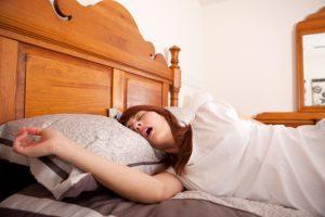 snoring woman in sleeping in bed