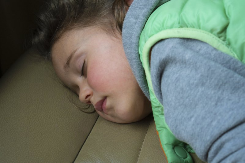 child sleeping face down