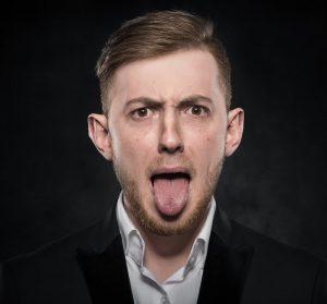 man tongue out tongue-tie