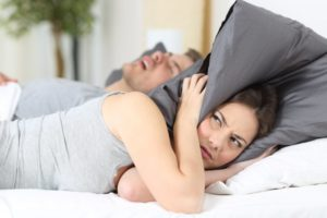 wife annoyed by husband's snoring